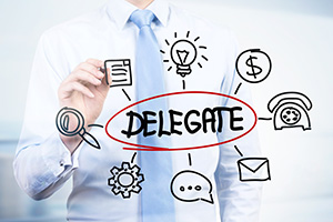 Photo of man trying to delegate