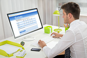 Man at computer completing survey
